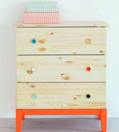 bright orange legs and a frame plus colorful knobs make this Tarva dresser bold and fun