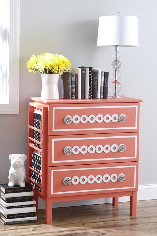 a coral Tarva hack with white inlays, glass knobs and a side magazine or book holder