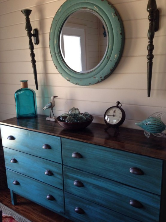 a turquoise Tarva dresser with a dark stained countertop and vintage handles for a coastal home