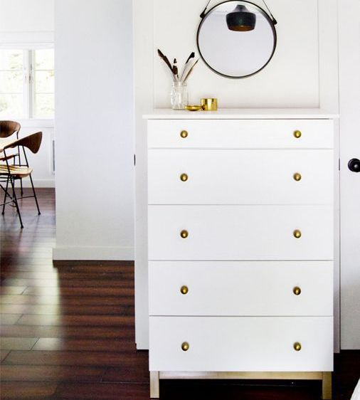 a white Tarva with brass knobs is a stylish and timeless storage piece, and the color combo is perfect