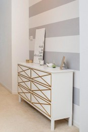 a white Tarva dresser with elegant geometric gold inlays is a cool piece for a bedroom or an entryway