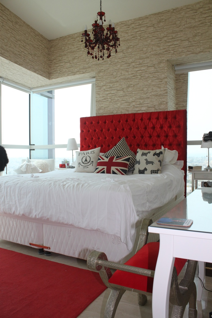 a bright glam bedroom done with bright red touches and a faux stone statement wall   doing that with wallpaper or panels is easy