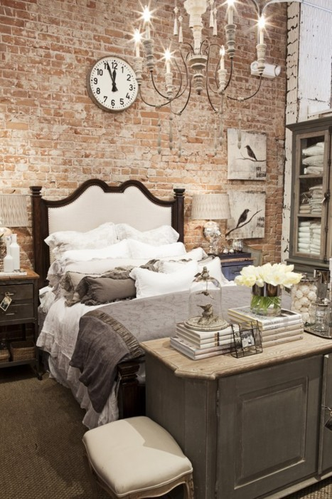 an elegant vintage bedroom is made more modern and edgy with an exposed brick wall, which reduces the level of polish