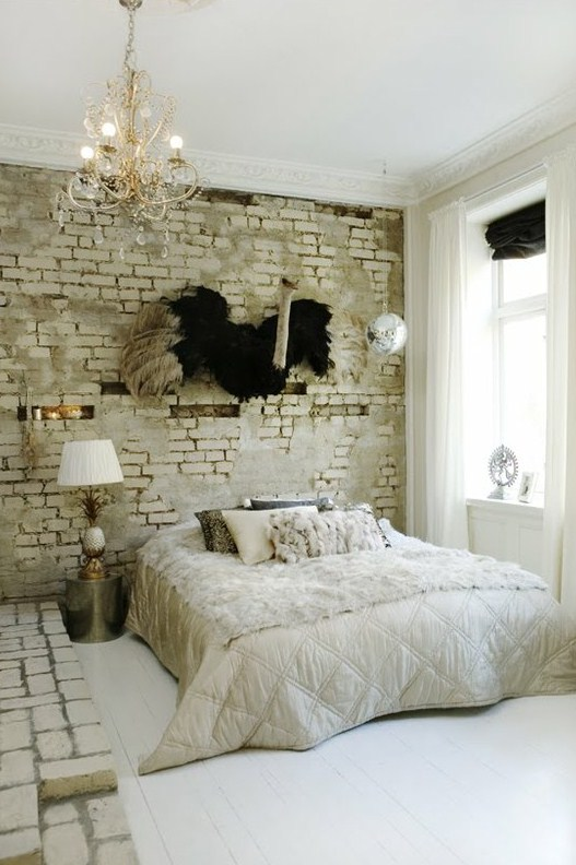 chic and glam furniture and accessories are calmed down with a white brick wall and platform that add a raw feel