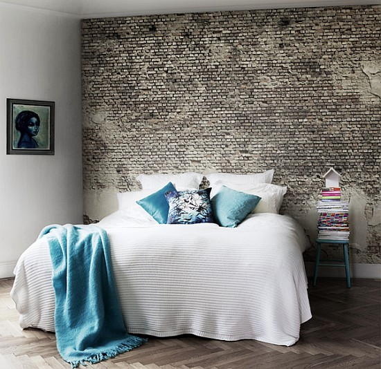 a contemporary bedroom with a faux brick wall done with wallpaper, it's an easy way to add interest to the space