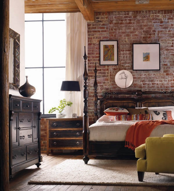 a vintage meets mid century modern bedroom is made edgy and more harsh with an exposed brick wall