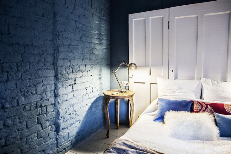 paint your brick wall with any color you like and that matches your home decor, here teal paint gives a unique look to the bedroom