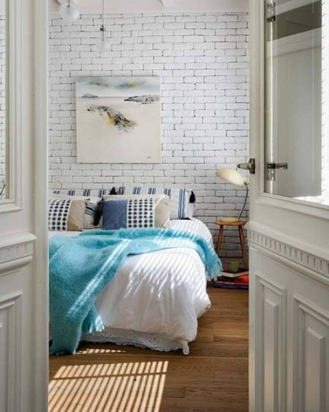 refresh your simple bedroom with a fake white brick wall, which is easy to recreate with panels