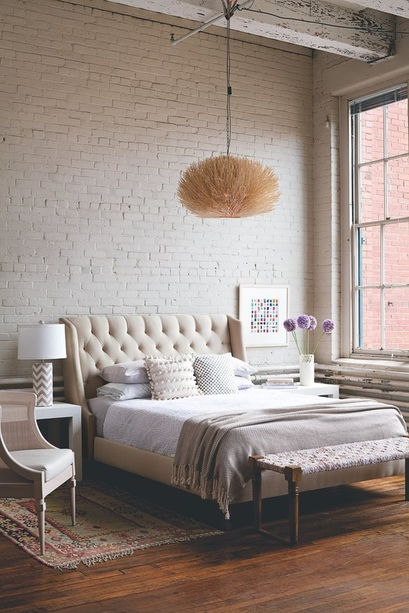 a cute girlish bedroom with a vintage feel features a white brick statement wall that adds a harsh and edgy touch to the area