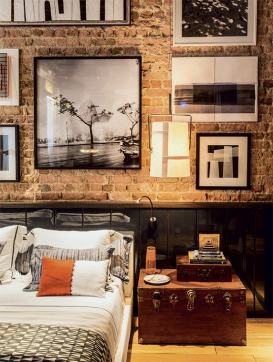 a vintage industrial bedroom with a brick wall and sleek black panels, vintage furniture and a gallery wall