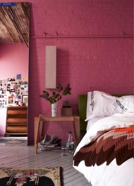 a fuchsia brick wall is a unique idea that will give a character and a unique look to the bedroom