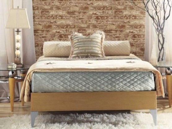 a contemporary bedroom in beige and grey with a faux brick wall for a stylish accent at the headboard