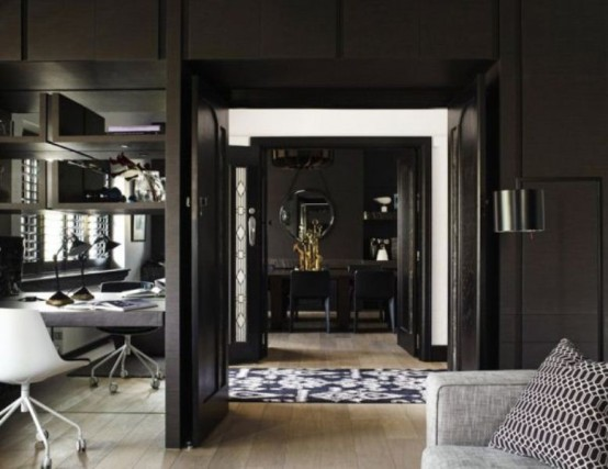 Impressive Black Interior Design With Gold And Orange Accents