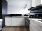 Impressive Black Interior Design With Gold And Orange Accents