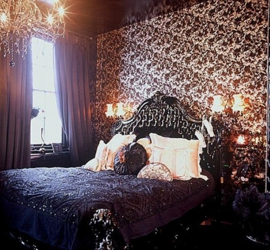 a refined Gothic bedroom with printed wallpaper, exquisite furniture, a crystal chandelier and wall sconces for a vintage feel