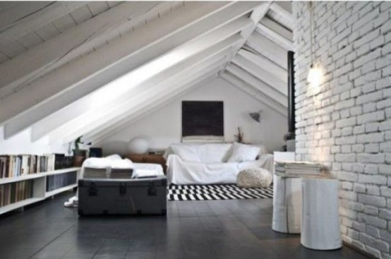 a Nordic attic room with a whitewashed brick wall, a hearth, modern furniture, a chest and open shelves with books
