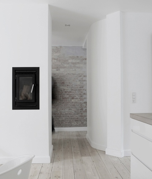a very laconic Nordic space made interesting and catchier with a whitewashed brick wall as an accent, it brings texture
