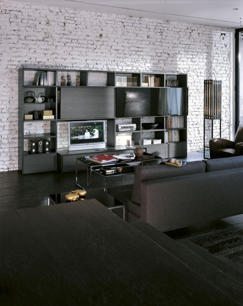 a contemporary living room with whitewashed brick walls, dark and black furniture and lamps is a stylish and catchy space