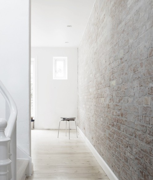 a Nordic and airy space can be finished with a whitewashed brick wall and