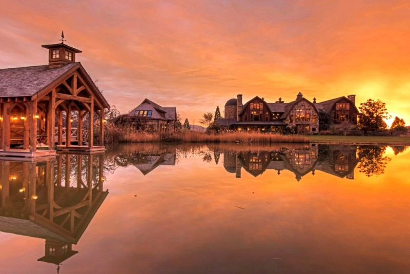 Picture Of incredible barn mansion made of wood and stone in utah  23