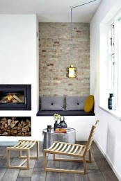 a Scandinavian space with a built-in fireplace and firewood storage, an upholstered built-in bench with pillows is a welcoming and cool nook