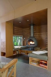 a special fireplace nook with daybeds with storage, a hearth and a window is aimed at enjoying coziness here