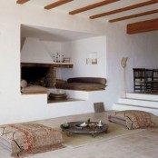 a welcoming fireplace nook with raised benches with cushions is amazing for staying there and relaxing