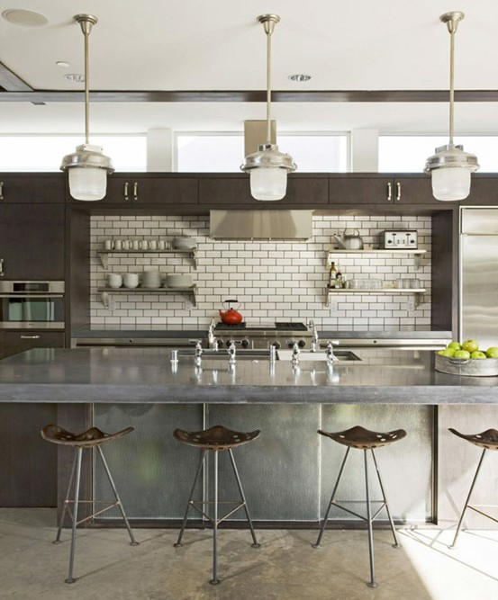 Modern take on industrial style kitchen design where metal surfaces are stainless steel. It's really practical.