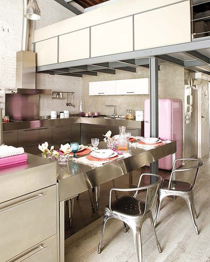Who said a industrial kitchen can't feature colorful appliances? A pink SMEG fridge looks amazing on this one.