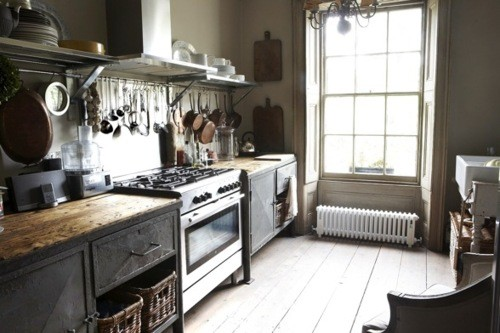 Railing for kitchen utensils and copper pots is more than welcome on a smart industrial kitchen.