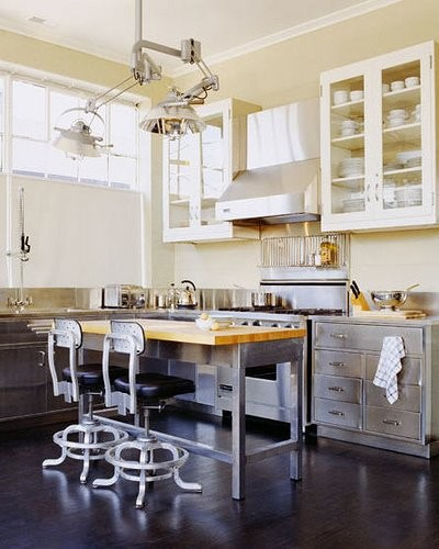 Industrial lamps are those things that are more than welcome in many interiors. Lovely vintage chairs look great on this kitchen too.