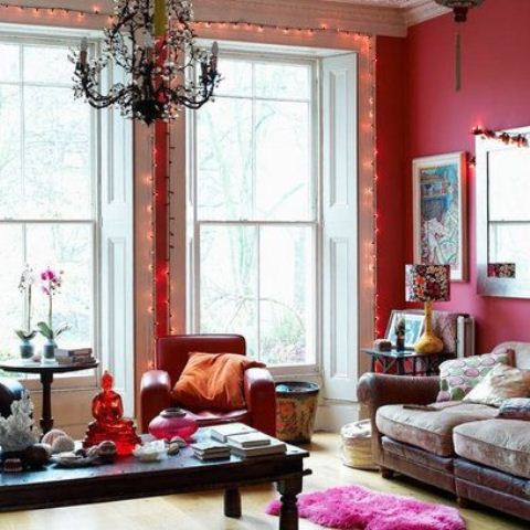 Different shades of pink could be found in most bohemian living spaces. That could be as small details like throw pillows as even whole walls painted in this color.