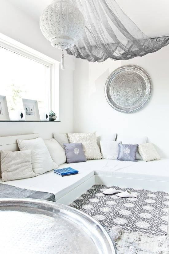 This airy living space is definitely perfect for a cozy weekend, surrounded by lots of throw pillows.