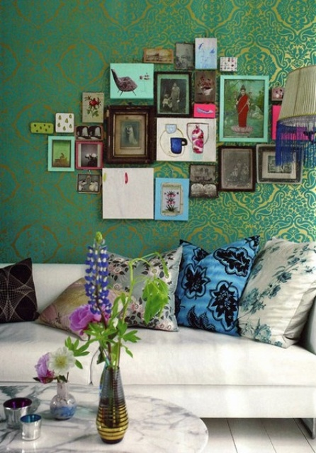 Distinctive miniature artworks cover shiny patterned wallpaper in this room but their group definitely makes statement too.