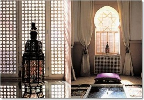 a neutral Moroccan bathroom with a catchy window shutter, curtains, a purple pillow and sunken bathtub