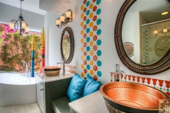 colorful star-shaped tiles to accent the wall, copper hammered sinks and chic mirror frames