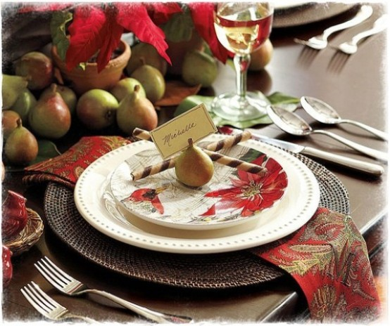 a rustic Christmas tablescape with woven chargers, printed napkins, potted blooms and pears
