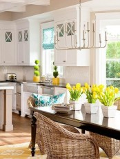 a blue and white pillow and bright yellow tulips and greenery are an easy idea to spruce up your kitchen decor