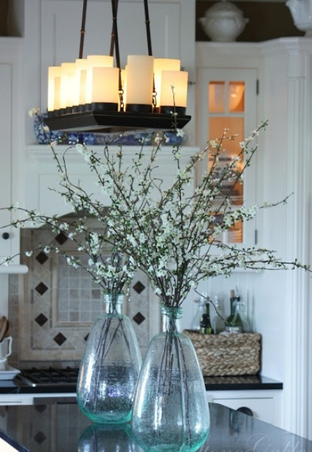cherry blossom in bottles are a great way to make any space feel more like spring and make it blooming, too