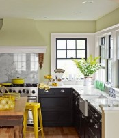 bright yellow items, lemons and cookware make the kitchen feel spring-like and yellow blooms echo with them all