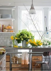 fresh blooms in green, white and yellow and greenery make the kitchen feel more spring-like, bold and fun