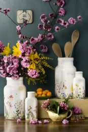 pink cherry blossom, bright yellow blooms and floral print vases make the kitchen feel fresh and spring-like