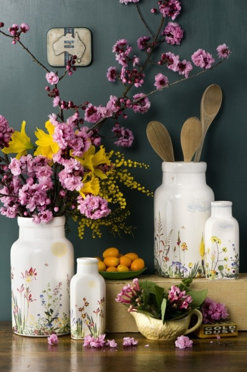 pink cherry blossom, bright yellow blooms and floral print vases make the kitchen feel fresh and spring like