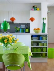 neon green linens, chairs, tableware and a green lamp refresh the kitchen and make it bright and fun