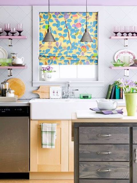 a lilac wall and matching shelves, a bright floral Roman shade plus lilac blooms make the kitchen look soft, tender and pastel-infused