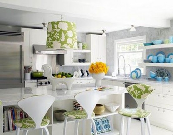 green botanical print chairs, a lamp and yellow blooms make the kitchen refreshed and bold