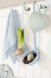 ladles with a faux nest with a blue egg and a spring bulb are cute touches for spring kitchen decor