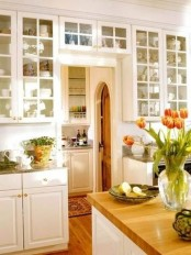 bright tulips in a clear vase are a nice way to add a spring touch to the kitchen easily