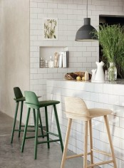fresh greenery in a clear jar and green chairs will make the kitchen feel more outdoor-like