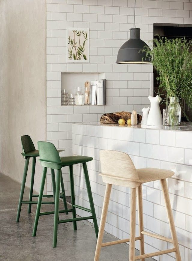 fresh greenery in a clear jar and green chairs will make the kitchen feel more outdoor like